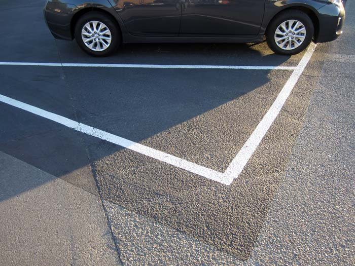 Parking lot lines and car - max clarke