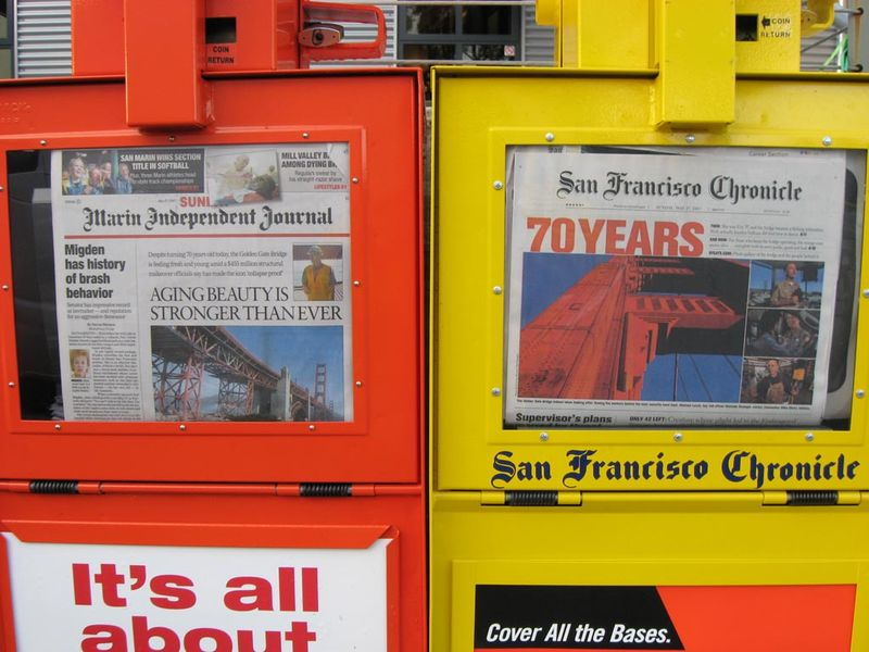 Newspaper racks 70th anniversary GGB - by Max Clarke