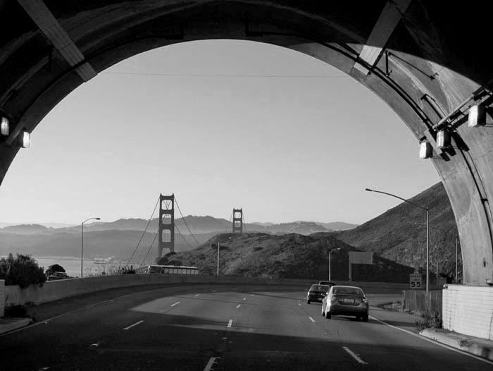 Black and white Golden Gate Bridge from tunnel - Max Clarke