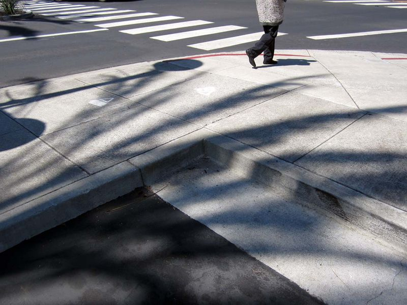 Pedestrian and red curb ©  photo by Max Clarke