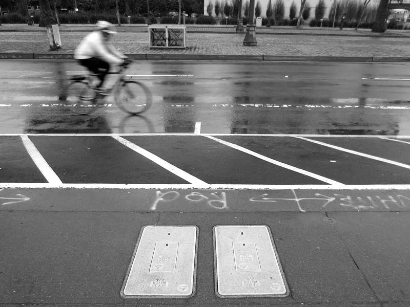 Bicycle Blur -BW- photo by Max Clarke