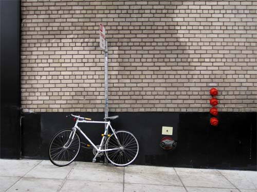 Bicycle by the Wall-©-photo by Max Clarke