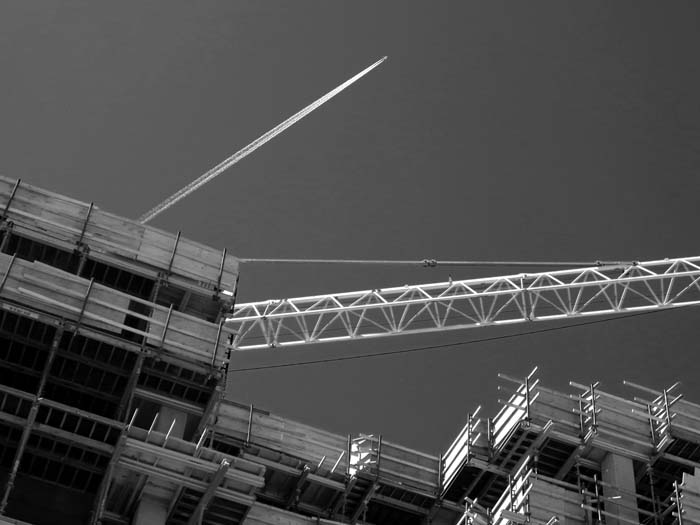 Contrail Over Construction-©-photo by Max Clarke