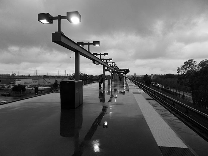 44 Coliseum BART station in the rain - Max Clarke